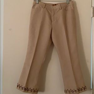 Tan pants with beaded embellishment on each leg.